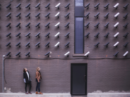 Women looking at security cameras by Matthew Henry